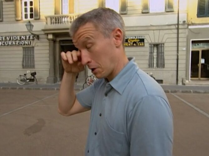 Anderson Cooper wipes away a fake tear after the unemotional reunion between Bill and his brother-in-law on The Mole 2: The Next Betrayal.