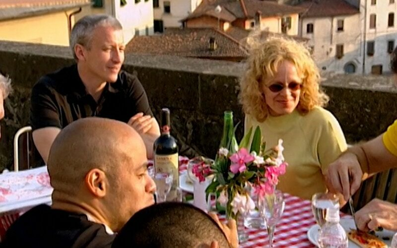 Anderson Cooper and Myra watch people eat pizza Myra helped prepared with unwashed hands.