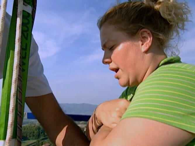 Katie gets ready to take a bungee jump plunge on The Mole 2, episode 8, which earns her a visit with her dad.