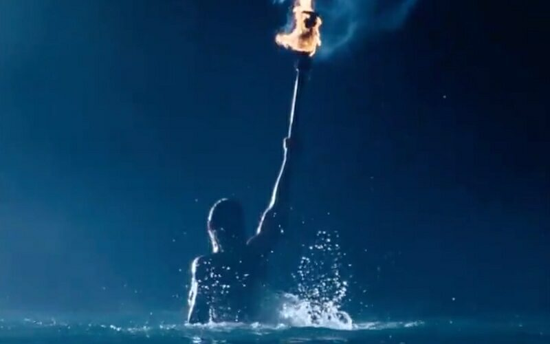 """Survivor 41's mysterious """"monster is coming"""" promo ends with this image of a person emerging from water holding a torch."""