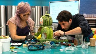 Cindy Ngar and Taylor Tabb, one of the teams on Netflix's Baking Impossible, work on a figure crafted out of watermelons