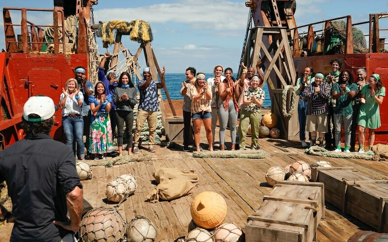 """Jeff Probst, lower left, talks to the cast at the start of Survivor 41, when he asked them if he should retire his phrase """"Come on in, guys."""""""