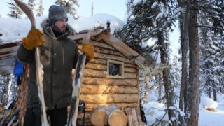 Johnny Rolfe in front of his cabin on Life Below Zero: Next Generation