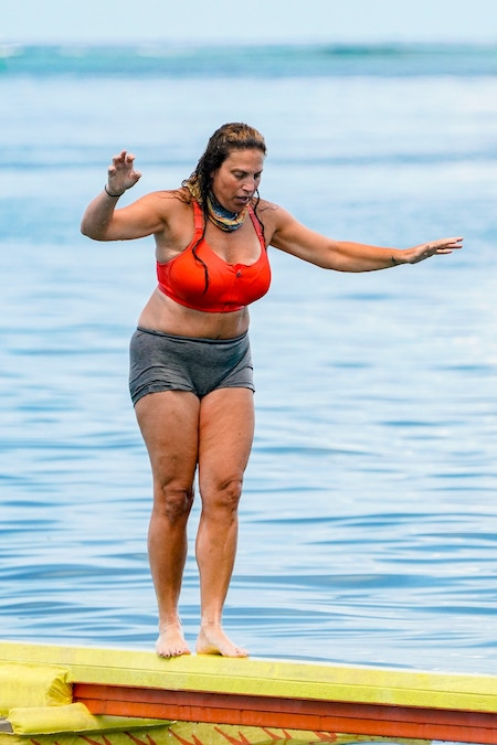 Tiffany Seely attempts to cross a balance beam during Survivor 41's second episode
